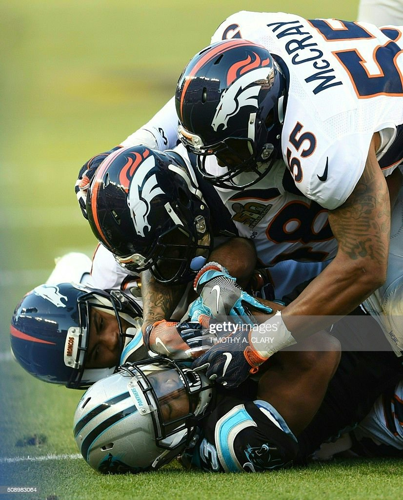Fozzy Whittaker (bottom) is tackled during Super Bowl 50 between the Carolina Panthers and the Denver Broncos at Levi's Stadium in Santa Clara, California February 7, 2016. / AFP / TIMOTHY A. CLARY