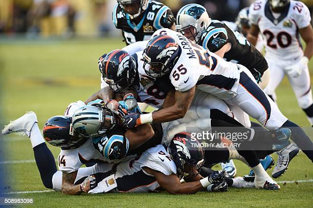 TOPSHOT Fozzy Whittaker is tackled during Super Bowl 50 between the Carolina Panthers and the Denver Broncos at Levi's Stadium in Santa Clara...