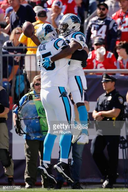 Fozzy Whittaker of the Carolina Panthers celebrates with Matt Kalil after scoring a touchdown during the second quarter against the New England...