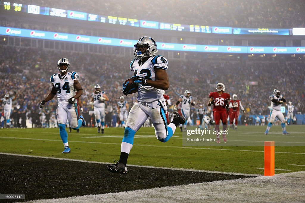 Fozzy Whittaker #43 of the Carolina Panthers runs for a touchdown against the Arizona Cardinals after a 3rd quarter reception during their NFC Wild Card Playoff game at Bank of America Stadium on January 3, 2015 in Charlotte, North Carolina.