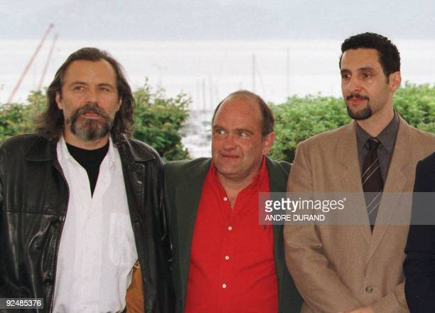 Fr L to R actor Rade Serbedzija Italian actor Teco Celio US actor John Turturro pose for photographers 13 May for the presentation of their film 'La...