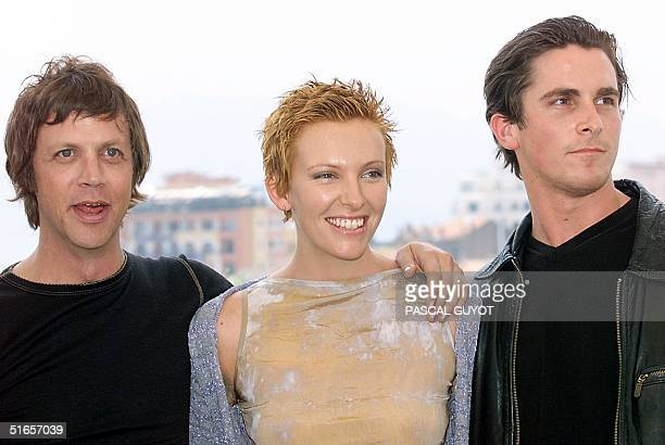 Fr L to R US director Todd Haynes actress Toni Collette and actor Christian Bale pose for photographers 22 May at a photocall for their film 'Velvet...