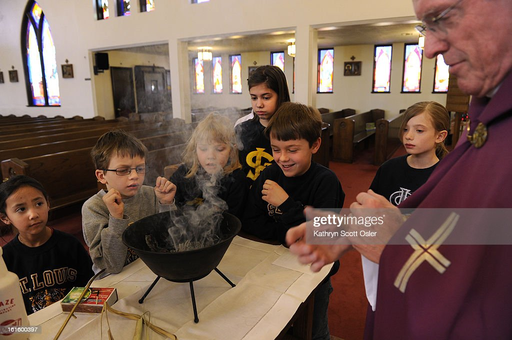Fr. Robert Reycraft, right, at St. Louis Catholic Church is joined by students from the St. Louis School in preparing the ashes that will be used in Ash Wednesday services. Fr. Reycraft gathered palm fronds and says a short prayer before lighting the palms. In the Roman Catholic Church, Ash Wednesday marks the first day of Lent, the season of preparation for the resurrection of Jesus Christ on Easter Sunday. Fr. Reycraft says that although Ash Wednesday is not a holy day, the celebration draws a big crowd at mass.