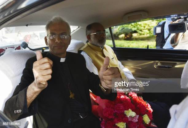 Fr Tom Uzhunnalil arrives at IGI Airport at Terminal 3 seen with Alphons Joseph Kannanthanam Union Minister of State for Electronics and Information...