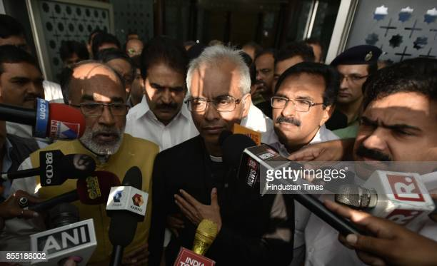 Fr Tom Uzhunnalil speaks to media as he arrives at IGI Airport at Terminal 3 seen with Alphons Joseph Kannanthanam Union Minister of State for...