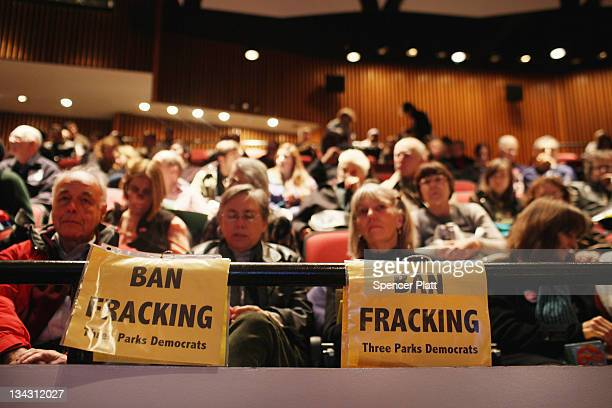 Fracking opponents attend a public hearing for supporters and opponents of gasdrilling or fracking on proposed fracking regulations in upstate New...