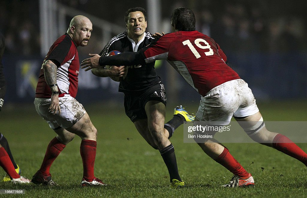 Frae Wilson of the Maori All Blacks is tackled by Brett Beukeboom of Canada during a tour match between Canada and Maori All Blacks at Oxford University Rugby Club on November 23, 2012 in Oxford, England.