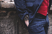 Fragment of a hand with a wristwatch, street style
