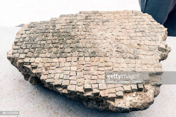 A fragment of mosaic flooring found during the new archaeological discovery that has emerged from the excavations of metro C in a well of aeration 10...