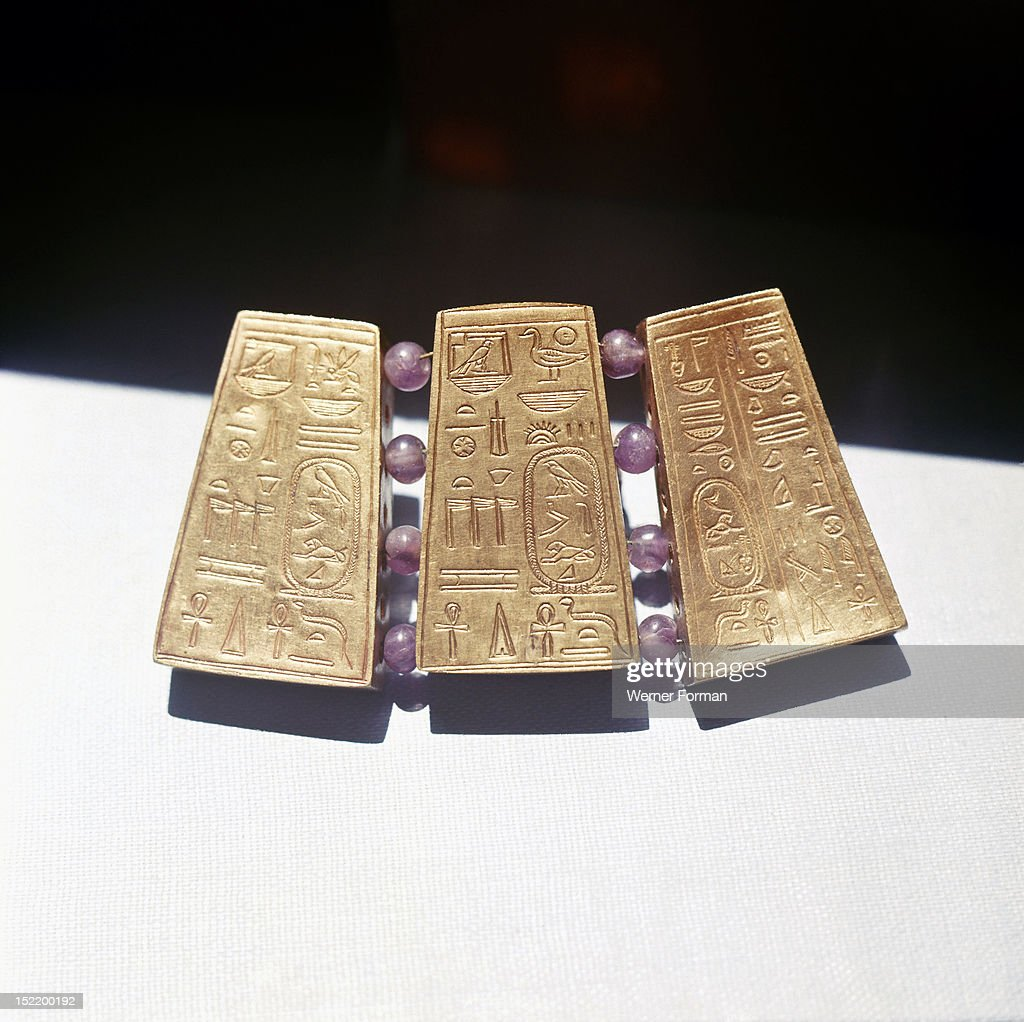 Fragment of Nubian jewellery with gold panels incised with Egyptian hieroglyphs including royal names Sudan Nubian Meroe or Napata