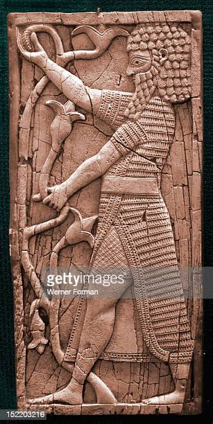 Fragment showing a warrior in ceremonial dress holding a lily Probably a furniture inlay from Fort Shalmaneser Nimrud High scan only Phoenician work...