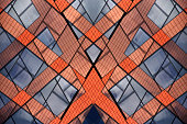 Modular structure of modern office or industrial buildings. Double exposure photo of abstract architectural pattern in vivid colors formed this symmetrical mosaic-like composition.