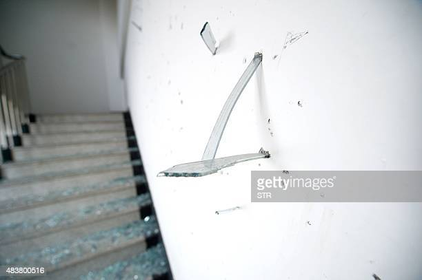 Fragments of glass windows are seen sticking in the wall of a stairway in a building near the site of the massive explosions is seen damaged in...