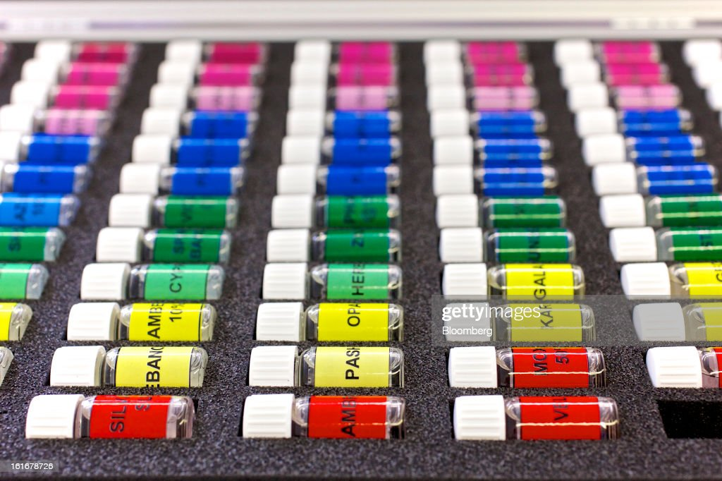 Fragrance samples sit in labelled and colored jars ahead of testing at Givaudan SA's scent research laboratory inside the company's headquarters in Dubendorf, Switzerland, on Wednesday, Feb. 13, 2013. Givaudan SA, the world's largest maker of flavorings and fragrances, announced a bigger-than-estimated dividend after riding out a year of high raw-material prices and a strong Swiss franc. Photographer: Gianluca Colla/Bloomberg via Getty Images