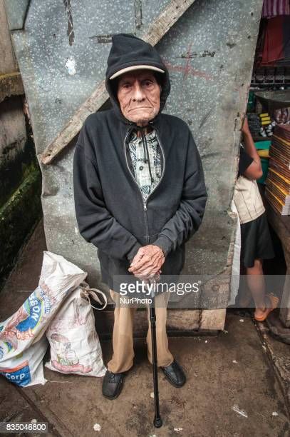 A frail elderly man stands in a food market in Jinotepe Nicaragua on 17 October 2011