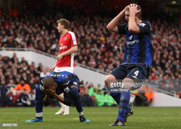 Fraizer Campbell misses a chance on goal with Michael Turner of Sunderland during the Barclays Premier League match between Arsenal and Sunderland at...