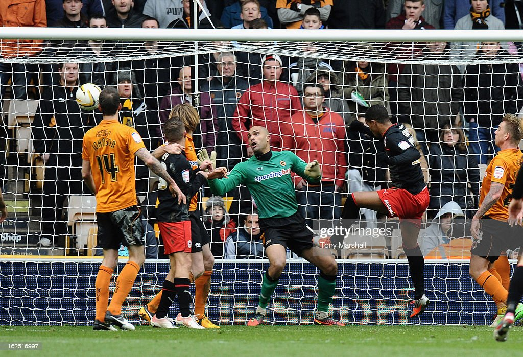 <a gi-track='captionPersonalityLinkClicked' href=/galleries/search?phrase=Fraizer+Campbell&family=editorial&specificpeople=2107990 ng-click='$event.stopPropagation()'>Fraizer Campbell</a> of Cardiff City scores theirfirst goal during the npower Championship match between Wolverhampton Wanderers and Cardiff City at Molineux on February 24, 2013 in Wolverhampton, England.