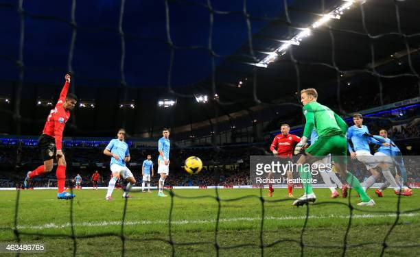 Fraizer Campbell of Cardiff scores his team's second goal past goalkeeperJoe Hart of Manchester City during the Barclays Premier League match between...