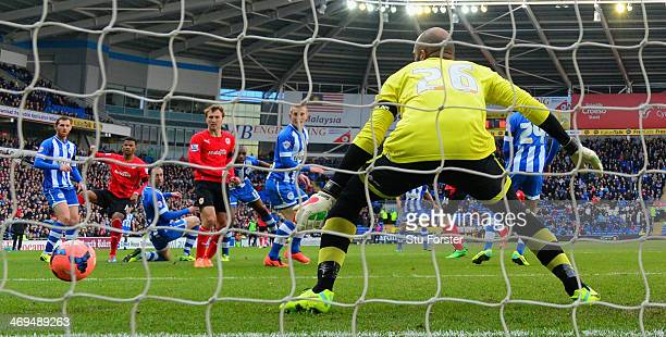 Fraizer Campbell of Cardiff scores the first Cardiff goal through a crowd of players during the FA Cup Fifth Round match between Cardiff City and...