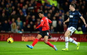 Fraizer Campbell of Cardiff shoots past Jonny Evans of Manchester United to score a goal to level the scores at 11 during the Barclays Premier League...