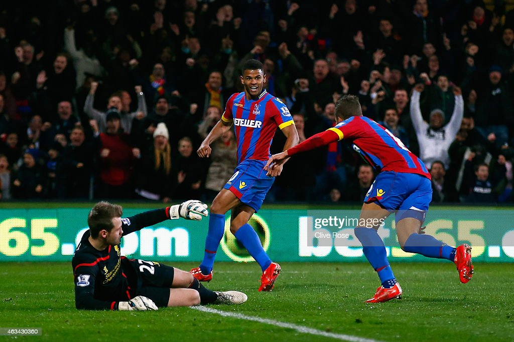 Fraizer Campbell of Crystal Palace (C) celebrates scoring the opening goal with Dwight Gayle of Crystal Palace during the FA Cup fifth round match between Crystal Palace and Liverpool at Selhurst Park on February 14, 2015 in London, England.