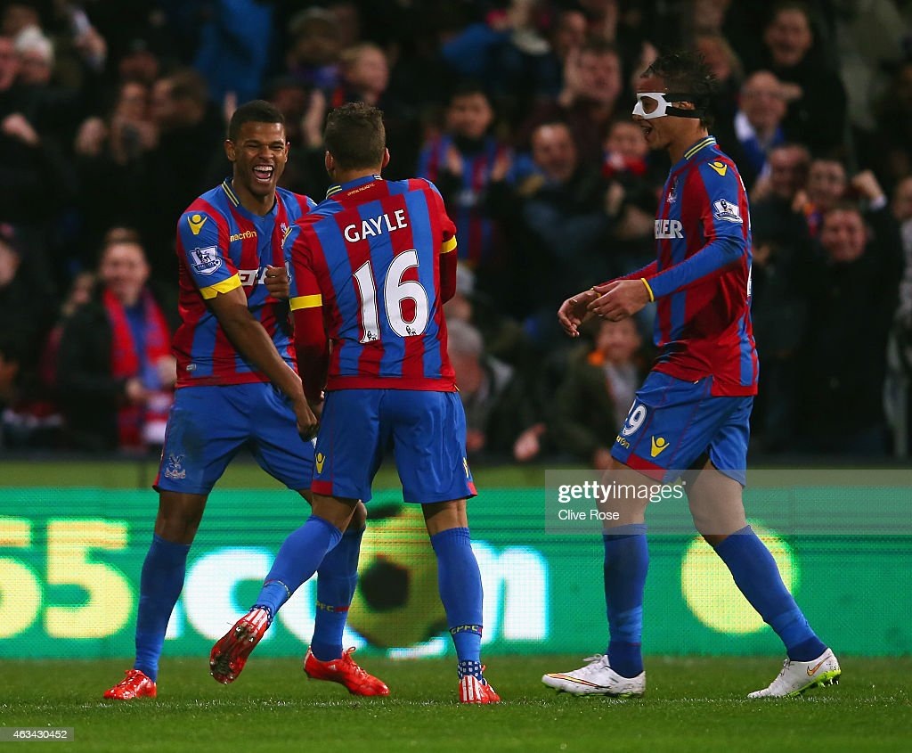 Fraizer Campbell of Crystal Palace (L) celebrates scoring the opening goal with Dwight Gayle and Marouane Chamakh of Crystal Palace during the FA Cup fifth round match between Crystal Palace and Liverpool at Selhurst Park on February 14, 2015 in London, England.