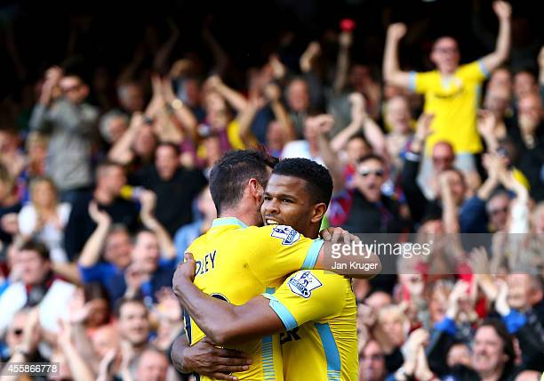 Fraizer Campbell of Crystal Palace celebrates with teammate Joe Ledley after scoring his team's second goal uring the Barclays Premier League match...
