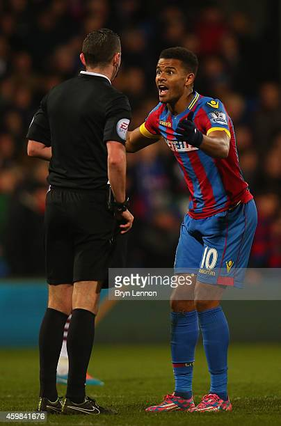 Fraizer Campbell of Crystal Palace protests to referee Michael Oliver before receiving a yellow card during the Barclays Premier League match between...