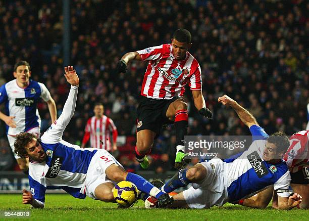 Fraizer Campbell of Sunderland leaps over a challenge from Gael Givet and Ryan Nelsen of Blackburn Rovers during the Barclays Premier League match...
