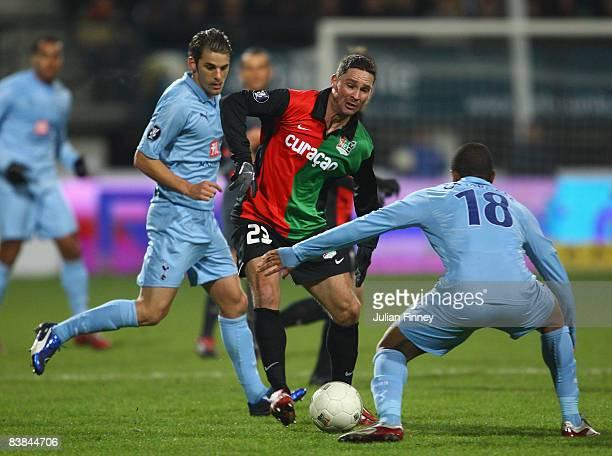 Fraizer Campbell of Tottenham Hotspur blocks Arek Radomski of NEC Nijmegen as David Bentley of Tottenham Hotspur watches behind during the UEFA Cup...