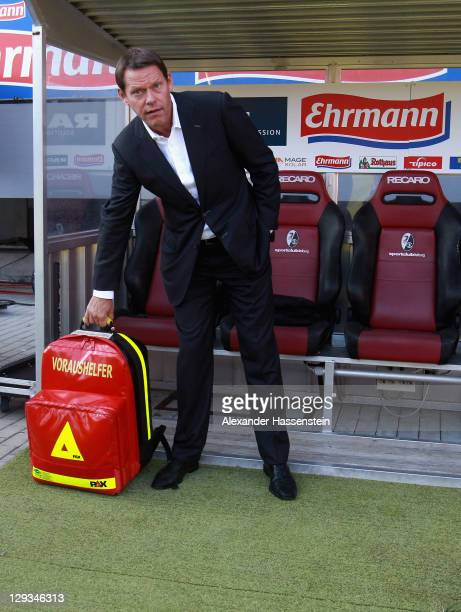 Frak Arnesen interim coach of Hamburg holds a first aid kit prior the Bundesliga match between SC Freiburg and Hamburger SV at badenova Stadium on...