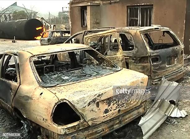 A frame grab made on December 25 2015 from a video shot the same day by TV Continental shows a burning cistern and burnt cars in the aftermath of a...