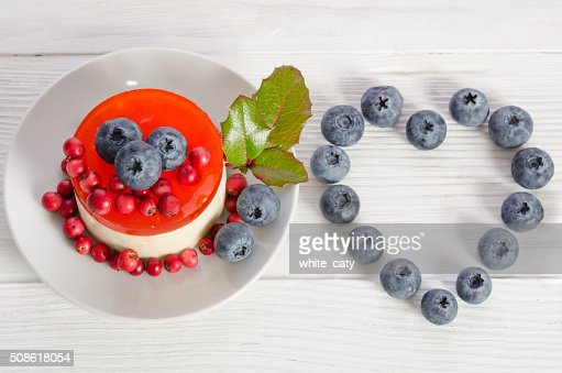 Frame- heart from blueberry and fruitcake on wooden table : Stock Photo