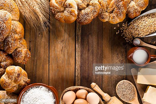 Frame of ingredients for bread preparation shot directly above