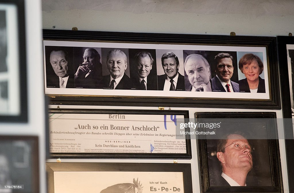 Framed autograph cards featuring photographs of German Chancellors Konrad Adenauer, Ludwig Erhard, Kurt Georg Kiesinger, Willy Brandt, Helmut Schmidt, Helmut Kohl, Gerhard Schroeder and Angela Merkel are seen in restaurant Staendige Vertretung on September 3, 2013 in Berlin, Germany. Germany is facing federal elections scheduled for September 22 and so far the Merkel and the CDU have a substantial lead in polls over the opposition.