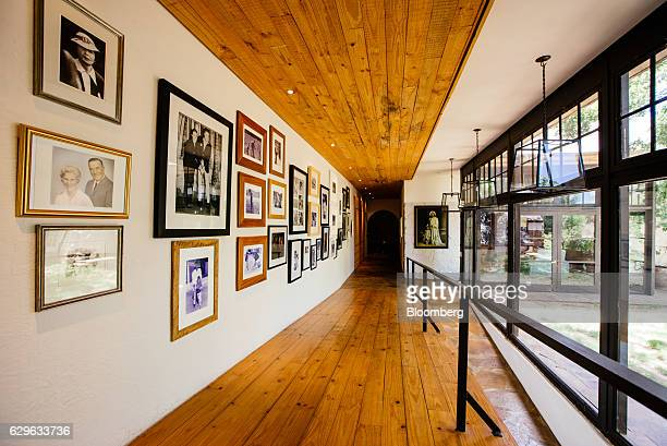 Framed family photos hang on the wall inside a hallway at the Rietfontein ranch and stud farm in Karoo Colesberg South Africa on Thursday Dec 1 2016...