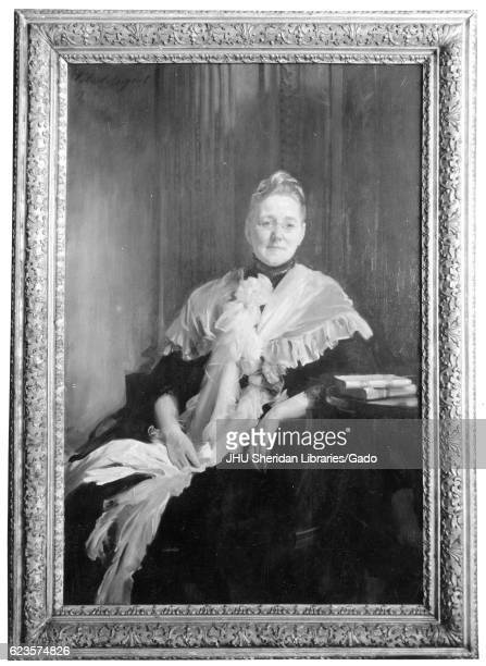 Framed photograph of a threequarter length painted portrait of Mary Elizabeth Garrett member of a prominent Baltimore family sitting wearing a dress...