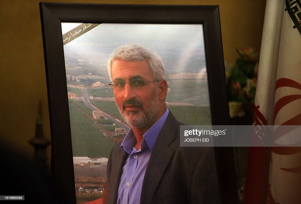A framed picture of assassinated Revolutionary Guards commander and Head of the Iranian Commission for the reconstruction of Lebanon, Hessam Khoshnevis, is displayed at the Iranian Embassy in Beirut on February 14, 2013, as the Iranian ambassador received condolences. Assailants shot dead the senior Iranian official in Syria while he was travelling by road towards the Lebanese capital overnight, the Iranian authorities said. AFP PHOTO/JOSEPH EID