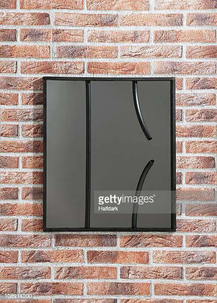 Framed picture of broken bars hanging on a fake brick wall