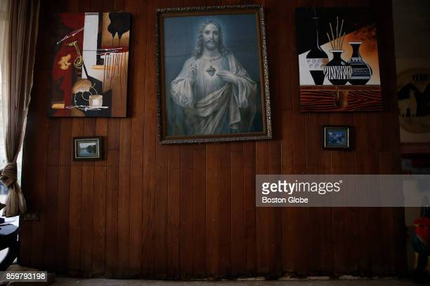 A framed poster of Jesus that Victor Ruiz Ramos had bought for his mother with money that he earned being a shoeshine boy at the age of 14 survived...