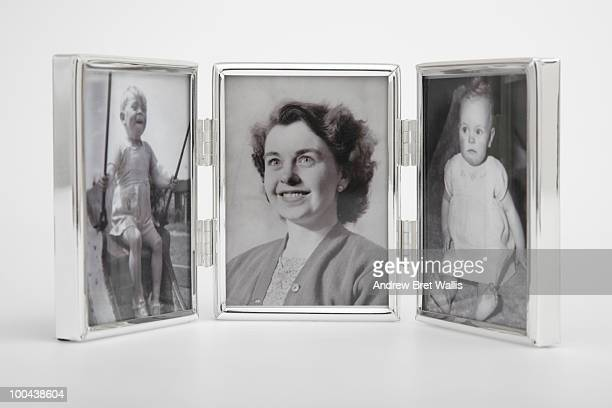 framed vintage photos of a mother and 2 children