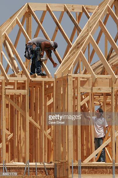 Framers work on a new home in the Westover Park subdivision June 16 2005 in League City Texas The US Commerce Department announced on June 16 that...