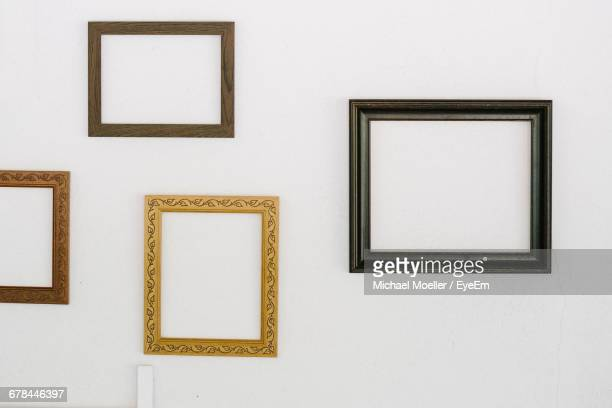 Frames Mounted On White Wall At Home