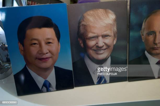 Frames of Chinese President Xi Jinping US President Donald Trump and Russian President Vladimir Putin are display in a photo shop in Beijing on April...