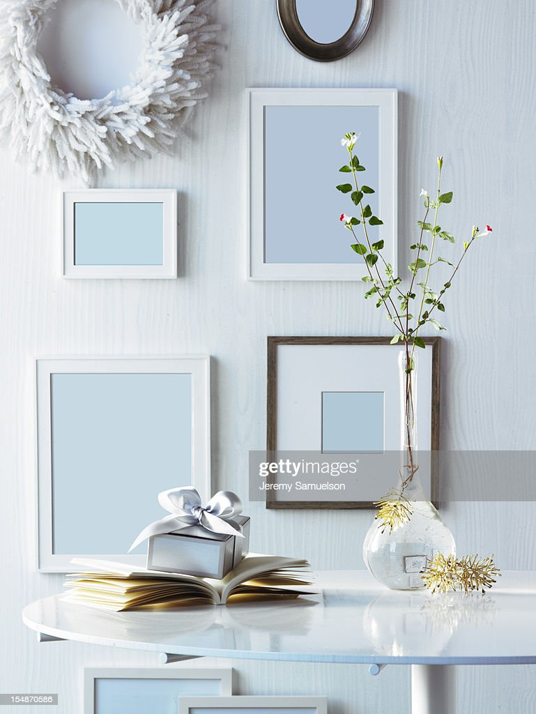 Frames on Wall with Present on Table : Stock Photo