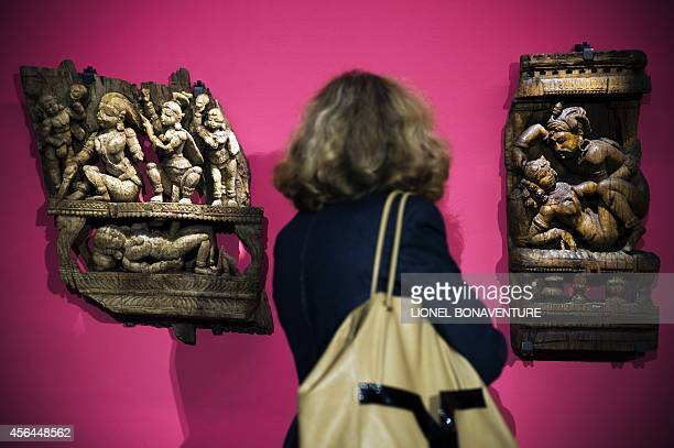 Fran Blandy A woman looks at sculptures as she visits the exhibition The KamaSutra spirituality and erotism in Indian art at the Paris' pinacotheque...