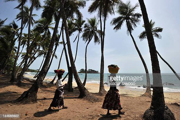 Fran Blandy Picture taken on April 29 2012 show the view of Tokeh beach near Freetown Bonewhite sand squeaks beneath your feet the curved beach...