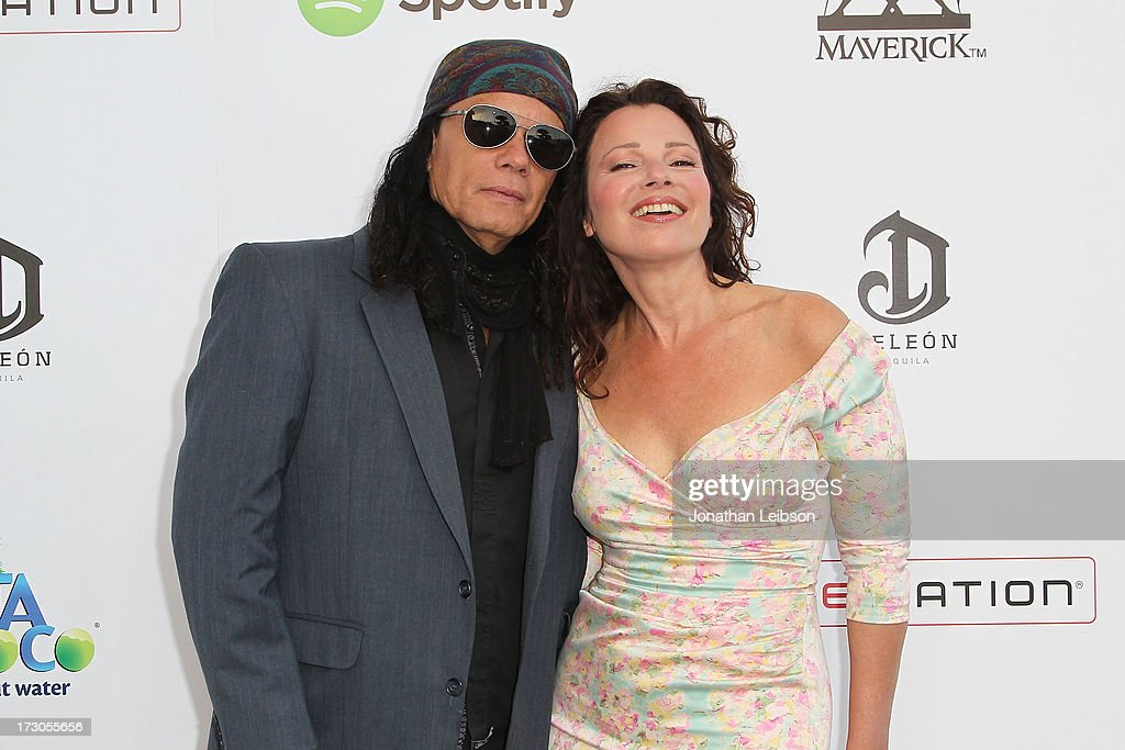 <a gi-track='captionPersonalityLinkClicked' href=/galleries/search?phrase=Fran+Drescher&family=editorial&specificpeople=201602 ng-click='$event.stopPropagation()'>Fran Drescher</a> (R) and guest attend the Guy Oseary's July 4th event in Malibu presented by Spotify and Live Nation with DeLeon and VitaCoco at Nobu Malibu on July 4, 2013 in Malibu, California.