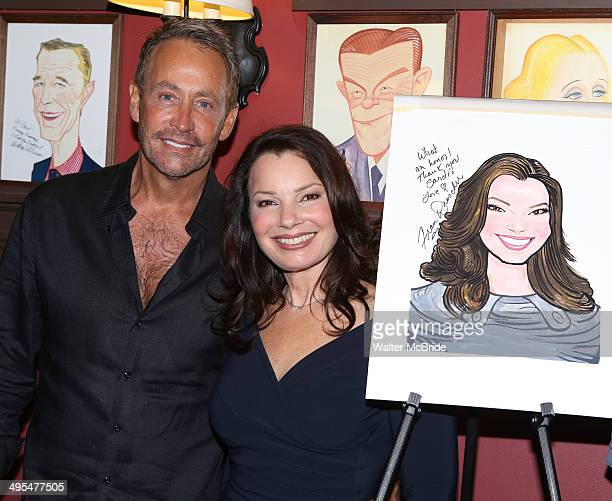 Fran Drescher and her ex husband Peter Marc Jacobson attend the Fran Drescher Portrait unveiling at Sardi's on June 3 2014 in New York City