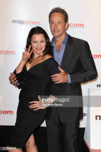 Fran Drescher and Peter Marc Jacobson attend the MIPCOM 2011 Opening Party at the Martinez Hotel on October 3 2011 in Cannes France